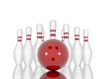 Pinos e bola de boliches em um fundo branco Fotografia de Stock Royalty Free