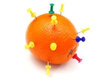 Pinos isolados do escritório empurrados na laranja Fotografia de Stock Royalty Free