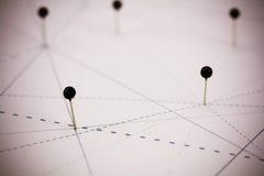 Pinos pretos no papel ligado por linhas fotos de stock royalty free