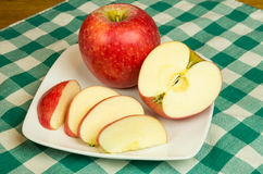 Pinova apple slices on white plate Royalty Free Stock Photography