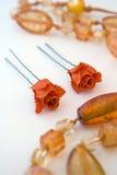 Pins. Orange pins on white background Royalty Free Stock Image