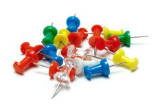 Pins. Colorful plastic pin heap on white background Royalty Free Stock Photography