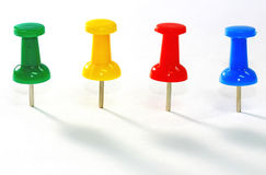 Pins. Group of colorful push pins on background Royalty Free Stock Image