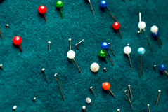 Pins. Of different colors on background royalty free stock image