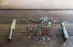 Pins as a meal Royalty Free Stock Image