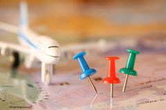 Pins attached to map, showing location or travel destination . retro style image. selective focus. royalty free stock photography