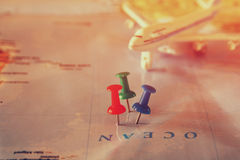 Pins attached to map, showing location or travel destination . retro style image. selective focus. Royalty Free Stock Image