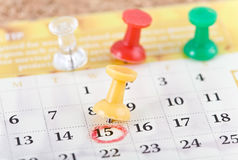 Pins and calendar. Background with red yellow green pins and calendar Stock Images