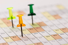 Pins on calendar. Green Blue and Yellow transparent Color Pins on calendar Royalty Free Stock Image