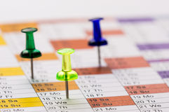 Pins on calendar. Green yellow and blue transparent Color Pins on calendar Stock Image