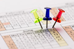 Pins on calendar. Red  yellow and blue transparent Color Pins on calendar Stock Photography
