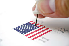 Pins on a calendar on the 4th July with USA flag Royalty Free Stock Photography