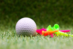 Pins and golf ball on green background. Pins and golf ball are on green background Stock Images