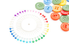 Pins and many buttons. Colored pins and many buttons on white background Royalty Free Stock Photos