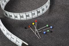 Pins and Measuring Tape. On fabric, ready for sewing Stock Photos