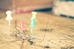 Pins on old map Royalty Free Stock Image