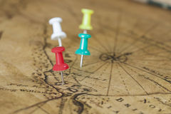 Pins on old map Royalty Free Stock Images