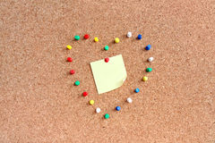 Pins on pin-board with notice. Pins in a heart shape on pin-board with notice Stock Images