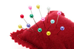 Pins and pincushion. On a white Stock Image