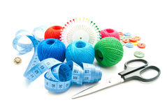 Pins, plastic buttons, meter, scissors and thread Royalty Free Stock Photos