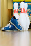 Pins and shoes. Bowling balls, bowling shoes and pins Royalty Free Stock Photography