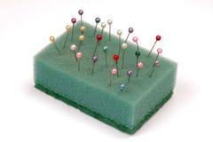 Pins in sponge Royalty Free Stock Image
