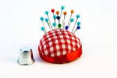 Pins and thimble Stock Photos