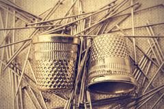 Pins and thimbles. Royalty Free Stock Photography