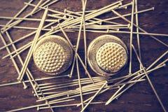 Pins and thimbles stock image