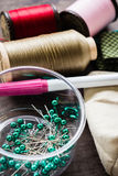 Pins and thread. Pins in plastic box with other sewing equipments Stock Images