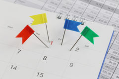Pins to Wildcats on the calendar beside the number of one. Royalty Free Stock Image
