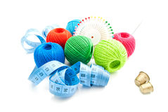 Pins, two thimbles, meter and thread Royalty Free Stock Photo