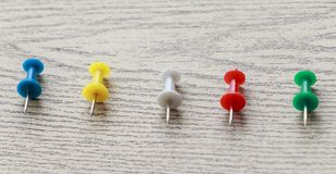 Pins on wooden. Colorful pin put on wooden table top background Royalty Free Stock Photography