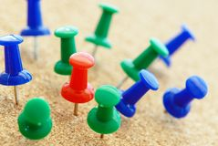 Pins on a wooden notice board Stock Image
