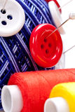 Pins in wool ball with buttons Royalty Free Stock Image