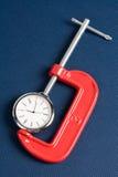 Pinsa ed orologio del vice Fotografie Stock