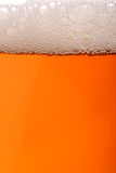Pint. A pint of beer with lots of frothy bubbles royalty free stock image