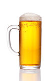 Pint of beer. Served in a stein glass stock photography