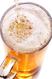 Pint of beer. Served in a stein glass stock photo
