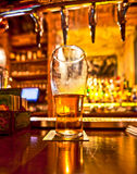 Pint of beer. On a bar in a traditional style pub stock photos
