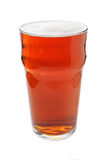 Pint of beer. Pint of bitter beer isolated on white royalty free stock photos
