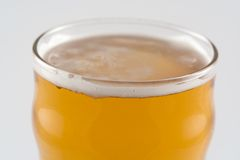 A Pint of Beer. Top of a glass of lager beer Stock Image