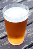 Pint of beer. On a table in a pub garden, copy space, close-up, macro Stock Photo