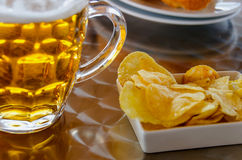 Pint of beer. Cold pint of beer with fried potatoes royalty free stock photo