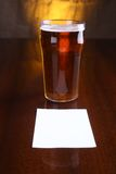 Pint of beer and note Royalty Free Stock Photos