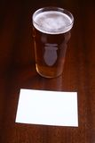 Pint of beer and note Stock Photos