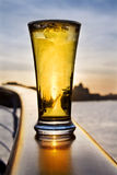 Pint of beer - over Dublin skyline. Pint of iced cold beer at sunset on a ship. Over Dublin skyline royalty free stock photos