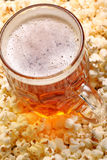 Pint of beer and popcorn with space for text Stock Image