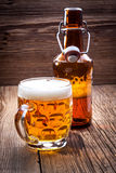 Pint of beer on a wooden table. Royalty Free Stock Photos