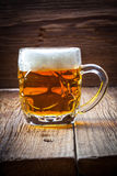 Pint of beer on a wooden table. Royalty Free Stock Images